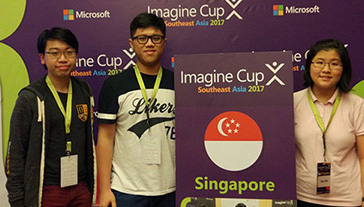 Three members of Heart Sound team holding a sign that reads: Imagine Cup. Southeast Asia 2017. Singapore.